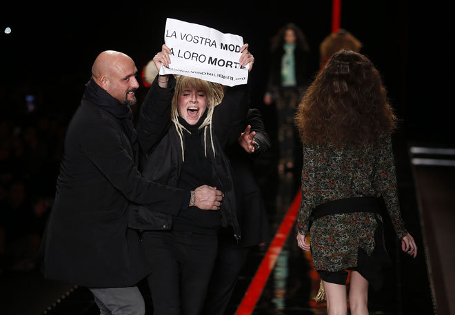 A cray cray fur protestor storms the runway at Just Cavalli - screams like four words and gets immediately removed. Models don't give a fuck.