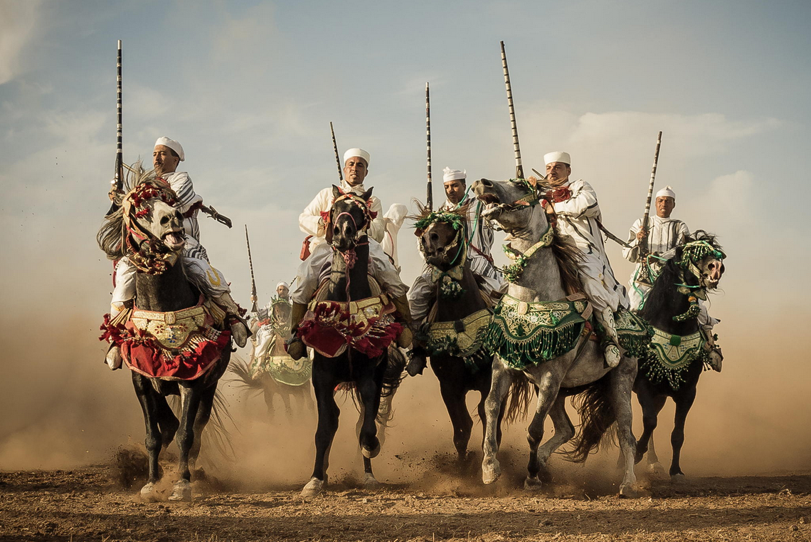 "Fantasia is a traditional equestrian performance practiced during cultural festivals in Morocco,and occurs traditionally to close Berber wedding celebrations in Maghreb. Fantasia is an imported name, the actual traditional term used is ""Game of gunpowder"".  Photo by Amine Fassi"