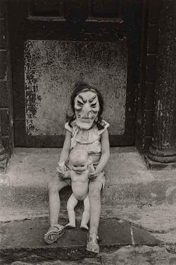 degeneratelowlife:  Diane Arbus - Masked Child with a Doll, 1961  lifespo