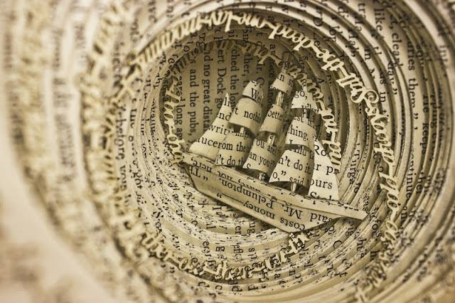escapekit:  Book Sculptures  Edinburgh-based graphic design student Thomas Wightman has produced a trio of astounding book sculptures for his graduation project.