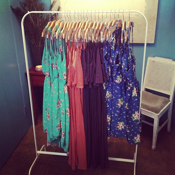 A bevy of beautiful dresses by #pinkmartini at the shop. #florals #dresses #spring (at Una Mae's)