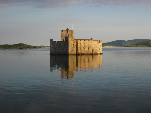 "archaicwonder:  Kisimul Castle  is a small medieval castle located in the centre of Castlebay on Barra, an island of the Outer Hebrides, Scotland. Kisimul Castle gets its name from the Gaelic words cìs (tax) and mul (mound) meaning ""The place where taxes are paid"". The earliest documentary record of Kisimul Castle dates from the mid 16th century. Kisimul sits on a rocky islet in the bay just off the coast of Barra, and as it is completely surrounded by the sea; it can only be reached by boat making the fortification impregnable. Kisimul has its own fresh water wells. Legend has it that this has been the stronghold of the MacNeils since the 11th century. Kisimul was abandoned in 1838 when the island was sold, and the castle's condition deteriorated. Some of its stone was used as ballast for fishing vessels, and some even ended up as paving in Glasgow. The remains of the castle, along with most of the island of Barra, were purchased by the chief of Clan MacNeill in 1937, who made efforts at restoration. In 2001 the castle was leased by the chief of Clan MacNeil to Historic Scotland for 1000 years for the annual sum of £1 and a bottle of whisky. by greasylightbulb"