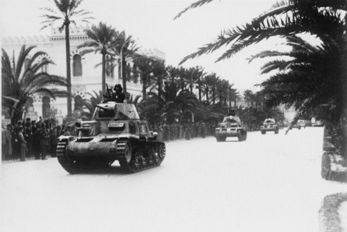 ww2inpictures:  Italian Fiat M13/40 medium tanks move along a street as civilians look on. Tripoli, Libya. March 1941.