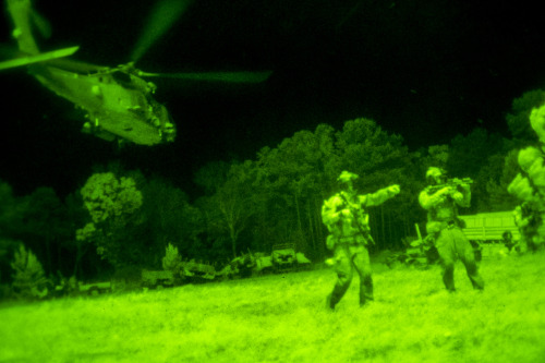 Evening Quickie #soldierporn: Let's see how deep the rabbit hole goes. A helicopter lifts off after inserting Navy SEALs to attack a simulated enemy threat during Operation Urban Corkscrew as part of Emerald Warrior 2013 on Camp Shelby, Miss., April 29, 2013. The SEALs extracted two simulated downed helicopter pilots and returned them to safety during the operation.