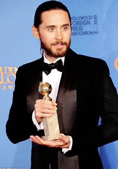 Jared Leto poses in the press room during the 71st Annual Golden Globe Awards.
