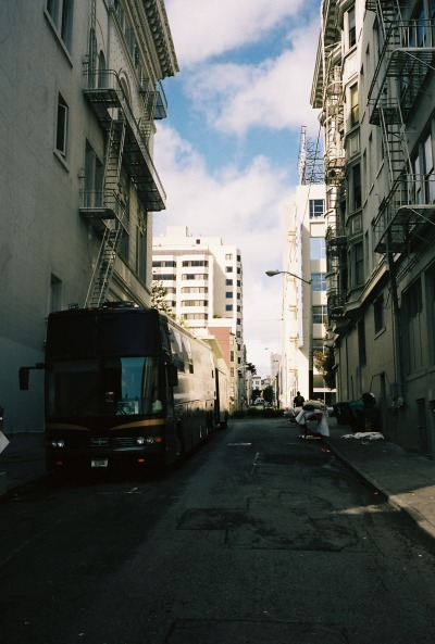 cldwrld-ttc:  San Francisco in the alley next to the venue. This was our tour bus. 12 bunk beds, 1 toilet that you may not shit in, 1 rape lounge in the back, tv and internet in the front lounge and an abusive racist bus driver. So many smells and stories. I hate it, but I miss it so much.