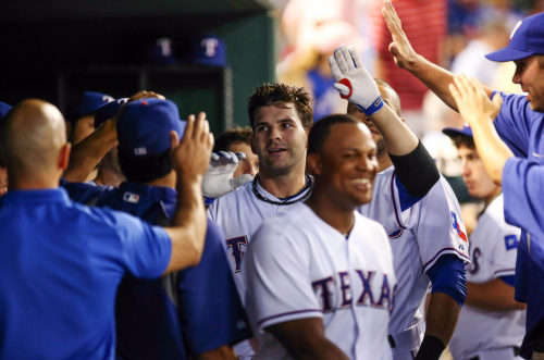 Texas Rangers first baseman Mitch Moreland celebrates with teammates after hitting a home run August 13, 1013.