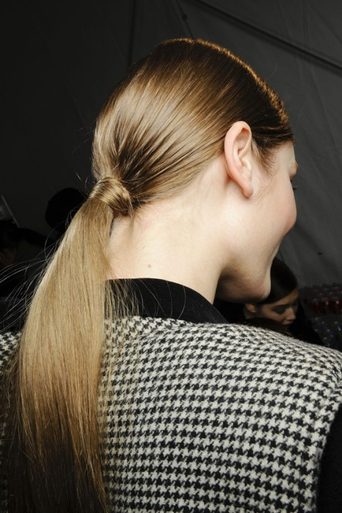 By now, we know pony tails are in. But we like this idea where you secure your ponytail at the nape of your neck and neaten up the look by wrapping a strand of hair around the band and keeping in place with a bobby pin.