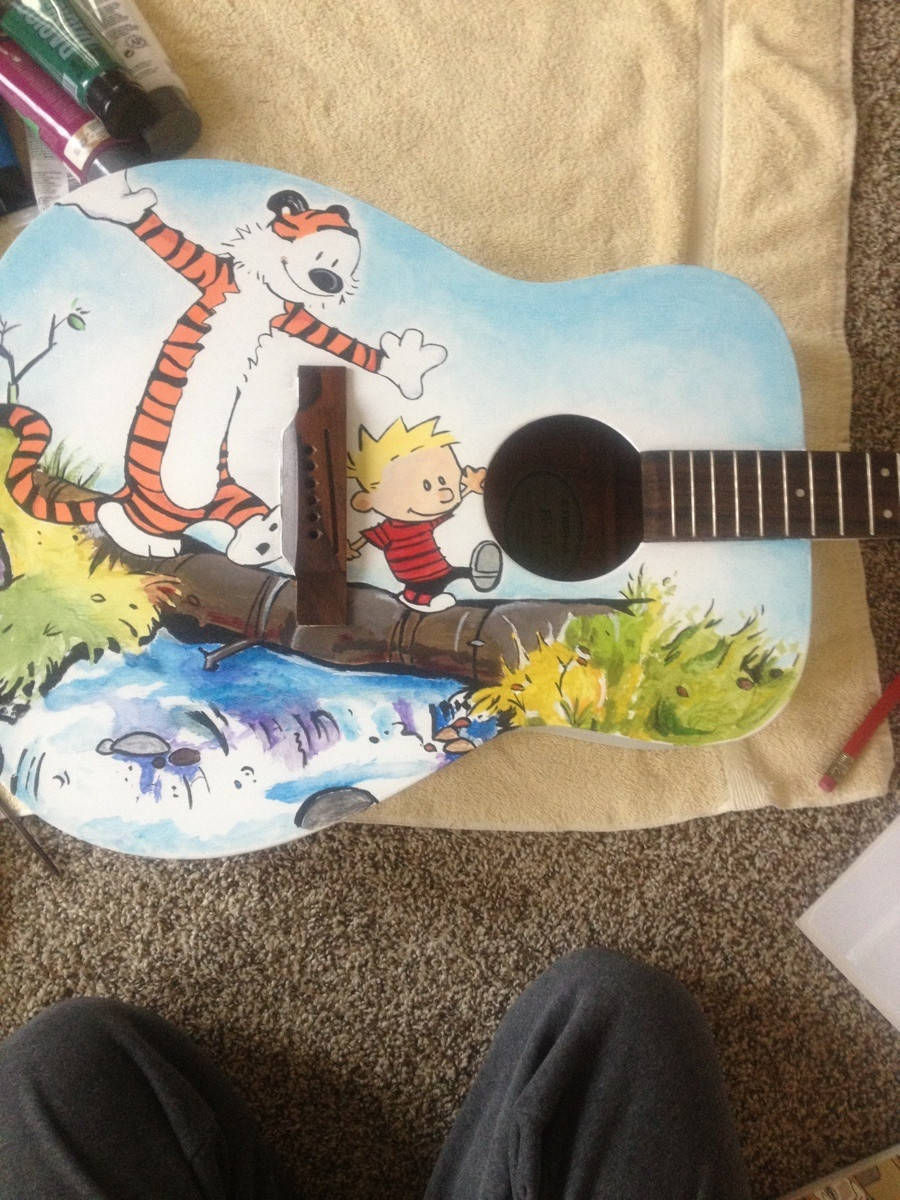 Officially, this is the greatest guitar paint job in the history of guitar paint jobs.  Via boingboing.net/2012/12/22/calvin-and-hobbes-guitar-refur.html