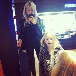 Me and my are sister playing in the mirror whilst Christian is trying on suits.