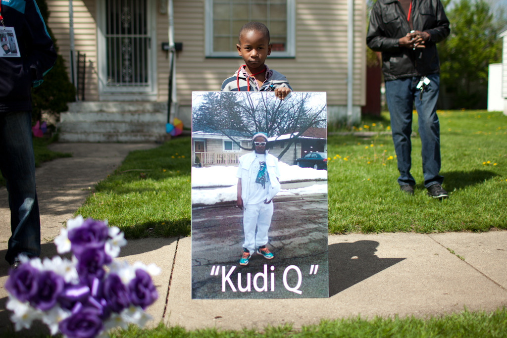 A couple weeks back I posted a photo from a vigil for Quiane Smith, who was gunned down on Aurora's west side. I was one of six people at that vigil, including another reporter and the four from a prayer coalition that organized it. They didn't call Quiane's family to let them know. Today, his family showed up in force to remember their son, grandson, nephew, father, cousin and friend.