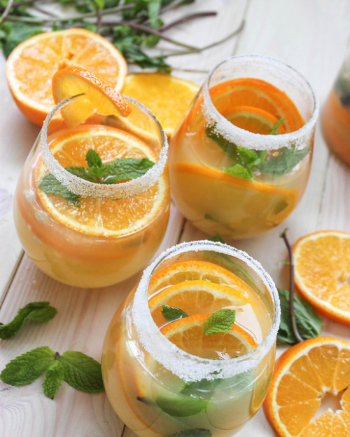 mothernaturenetwork:  jerryjamesstone:  Get the Tangerine Ginger Sake Sangria recipe  Drink up!