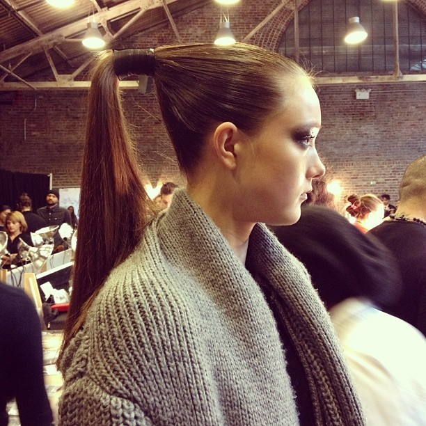 Donna Karan: Sharp Hair for Sharp Looks Here's a very sculptural hair inspiration found backstage at the Donna Karan show this past New York Fashion Week. The hair perfectly complimented the sleek black and tans displayed on the runway, seen here.  (Photo: officialstyledotcom. Text: Jauretsi)