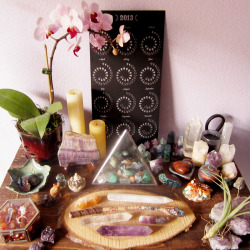 witch-moon:  my main altar after a bit of rearranging so i could make a home for my new orchid Lola. she already seems happy there.