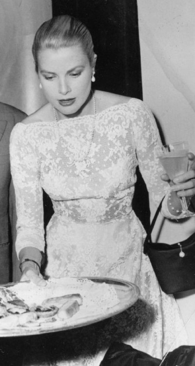 theniftyfifties:  Grace Kelly plays hostess.