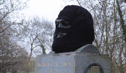 vandalog:  Balaclava at Karl Marx's grave by Ben Parry & Peter McCaughey for Cultural Hijack. Photo courtesy of Cultural Hijack.