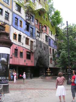 Hundertwasserhaus, Vienna, Austria [arch/artist Freidensreich Hundertwasser/Joseph Krawina] Colourful and a bit like a great big iced cake. Still has flat floors and vertical walls under the patterning though.