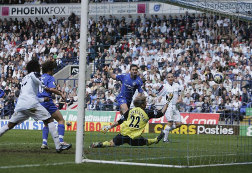 Bonus awesome photo: Frank Lampard scores the second goal against Bolton at the Reebok Stadium, 15 April 2006.