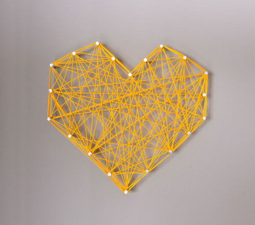 niftyncrafty:  Threaded Heart Wall Art | Handmade Charlotte Not only do I love this colour combo of yellow & grey, I love how easy this art is to create! If you want the heart to be a bit more 'round', just hammer in more nails. If you are a renter and your landlord isn't keen on you hammering nails into your wall, get yourself a piece of wood and hammer in to that (plus you get to take it with you!)