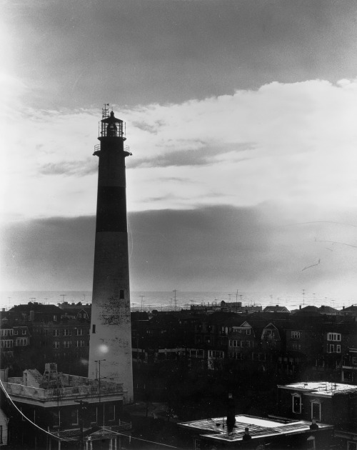 NIGHT VIEW OF LIGHTHOUSE SILHOUETTED AGAINST SEA AND SKY - Absecon Lighthouse, Pacific Avenue, between Rhode Island & Vermont Avenues, Atlantic City, Atlantic County, NJ, c. 1964. Photo: Jack E. Boucher.  Source: Library Of Congress