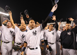 siphotos:  Derek Jeter, Mariano Rivera and the Yankees squad salute their fans during the final game at the old Yankee Stadium. (Chuck Solomon/SI) GALLERY: Rare Photos of Mariano Rivera