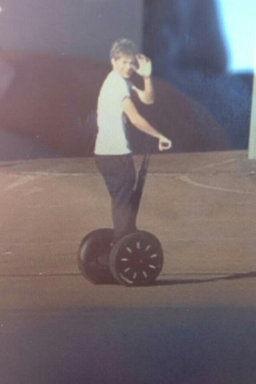 Niall on his Segway earlier. x
