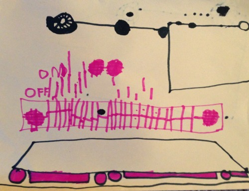 A keyboard with a train running under it. Jonah (age 4 1/2) April 2013