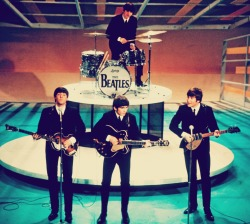 The Beatles performing live.