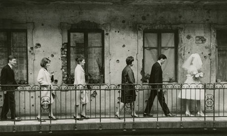 """Wedding, Budapest, 1965 by László Fejes, which, with its depiction of bullet holes in the wall, led to Fejes being banned from publishing his photographs. Photograph: Hungarian Museum of Photography"""