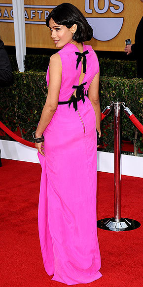Better From The Back? Freida Pinto Freida turns heads in a hot pink Roland Mouret gown with a bow-adorned back at the SAG Awards.
