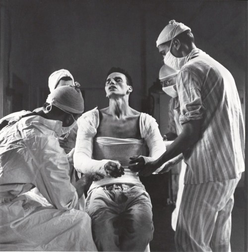 Army medic George Lott, wounded in both arms in November, 1944, grimaces as doctors mold a cast to his body. When Lott embarked on a 4,500-mile, seven-hospital journey of recovery, photographer Ralph Morse – astonished by the high level of medical care wounded troops received both at the front and behind the lines – traveled with him, and chronicled Lott's odyssey in a revelatory cover story for LIFE.