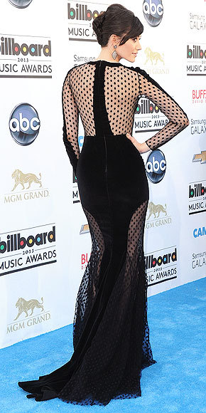 Better From The Back? Emmy Rossum at the Billboard Music Awards Just when we were feeling a little sheer-ed out, Emmy breaths new life into the trend with her velvet Zuhair Murad gown featuring a keyhole neckline and see-through polka-dot panels.