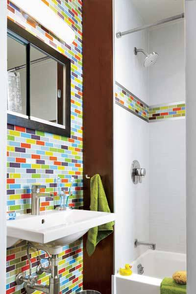 designmeetstyle:  A fun way to play with color in a small space. thisoldhouse:  Guarantee that nary a visitor will forget your home's small bath by imprinting a rainbow of glass mosaic tile on their brains. If an accent wall is too extreme, go for just a colorful band in the shower for a fun surprise. See more small bath design ideas