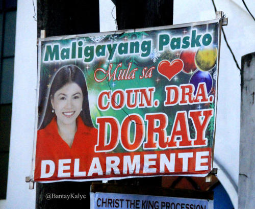 "The words ""Maligayang Pasko"" so much smaller than Coun. Doray Delarmente via @bantaykalye"