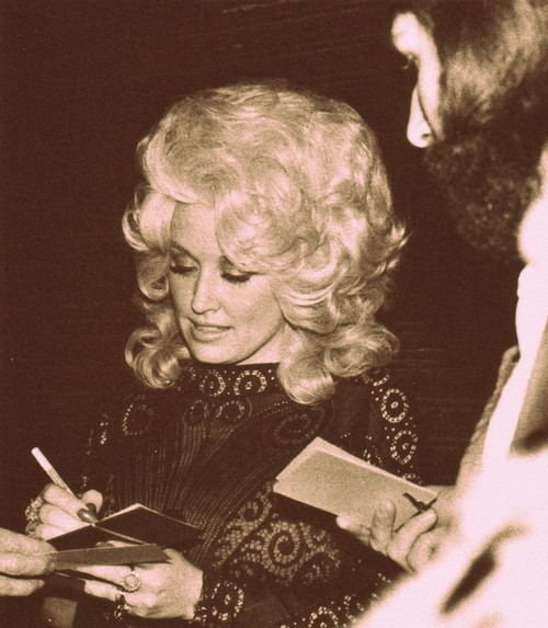 70's Dolly Parton signing autographs for fans