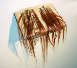 'Loose Ends' by Suvan Geer. Altered book with human hair. 1999. On display at 'PAGES'.