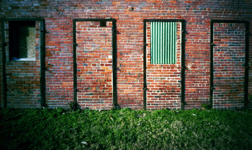 Pinhole: Decisions on Flickr.Four bricked-in iron doorframes on an abandoned building in Nashville, Tennessee Zero Image 69, Kodak Portra 160, about four seconds