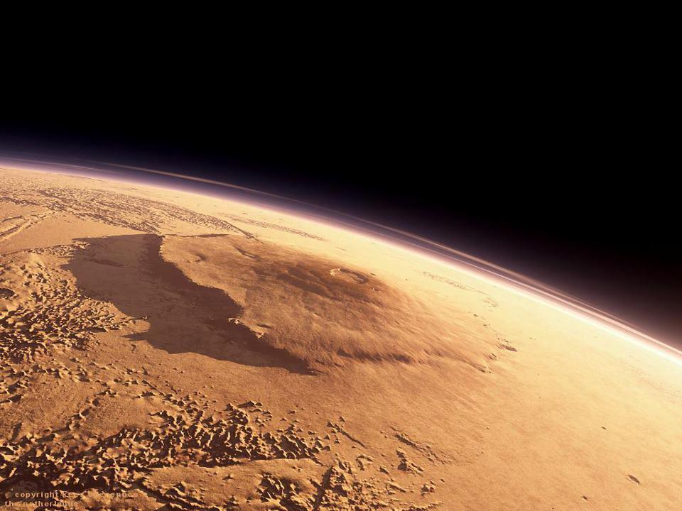 Mars Olympus Mons the tallest mountain in the Solar System.