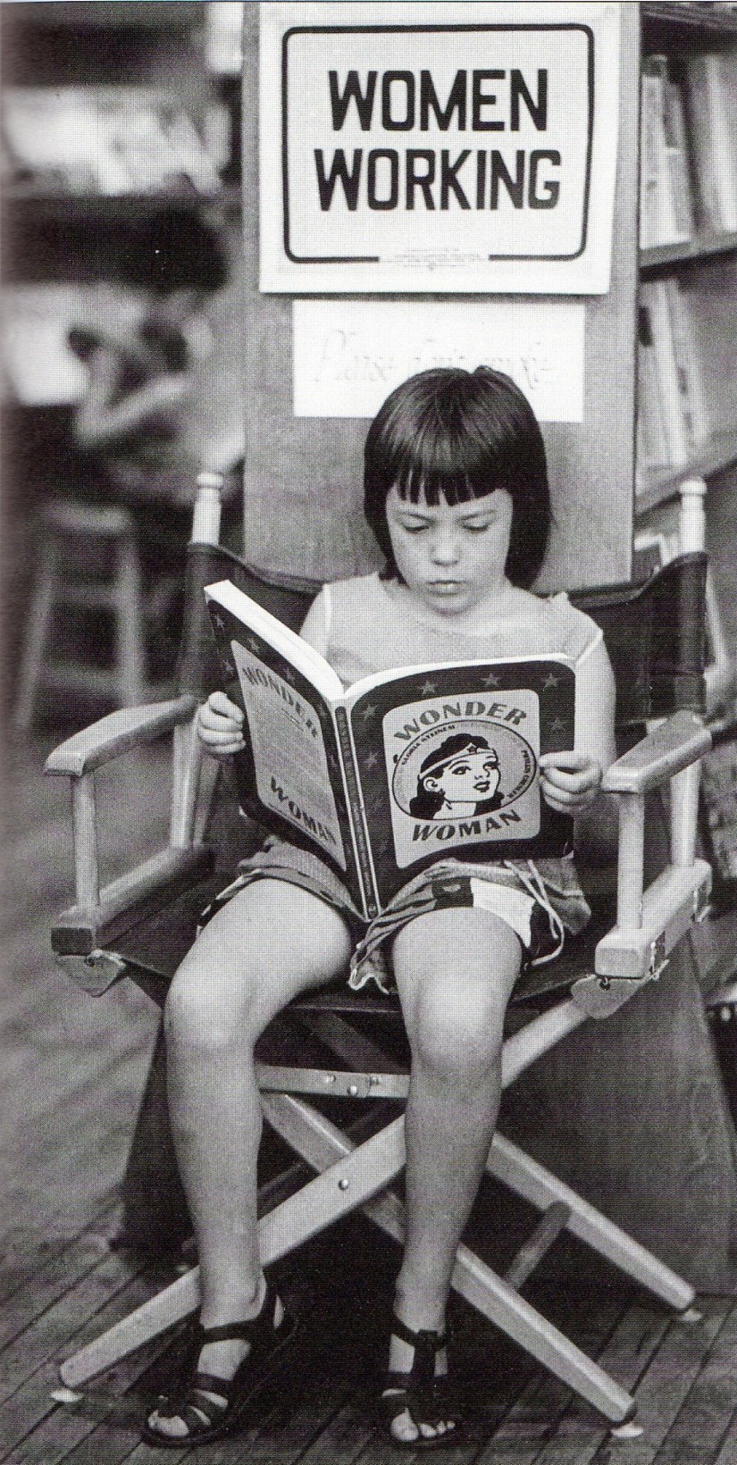 Unidentified young girl reads.