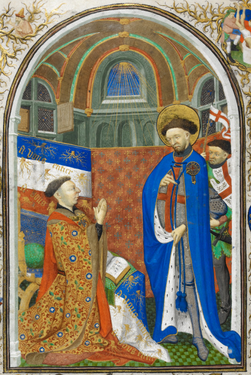 John Duke of Bedford, Regent of France, kneels in prayer before St George. The saint is shown wearing the mantle of a Knight of the Garter. The Garter can be seen below his left knee.  From the Bedford Book of Hours  Image;Wikipedia