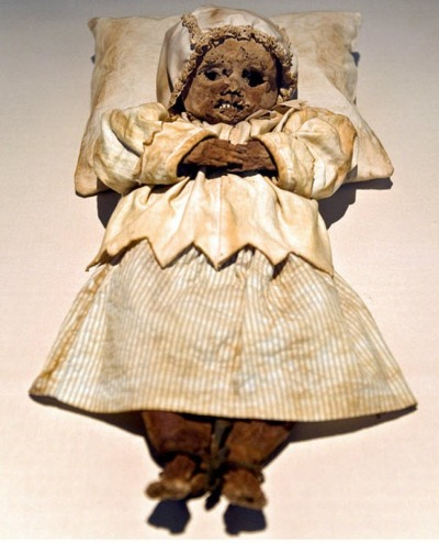 nuclearharvest:  Mummy Orlovitsa Johannes, who died at the age of one year. The dress and bonnet - a copy of original garments which was buried in.