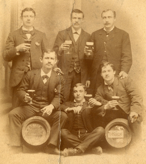 "Proud brewmeisters photographed with their ""bock"", 1880, Chicago. The barrels are hard to make out, but ""Chicago"" can be made out on the left and ""bock"" on the right. According to the print on the back, the photograph was taken at a studio at 650 Milwaukee Ave, Chicago. via Langdon Road"
