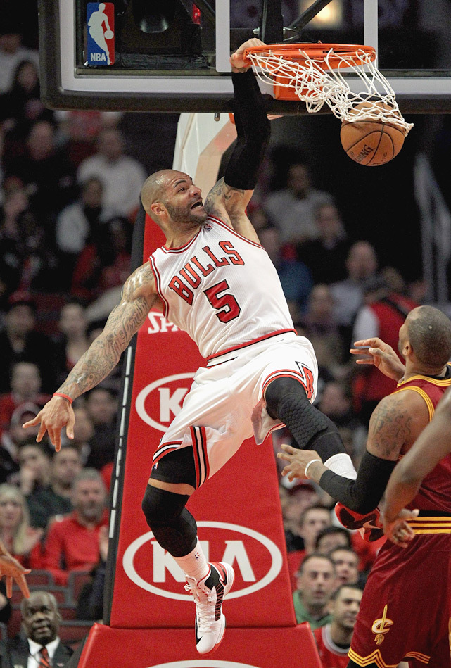 Carlos Boozer slames home a dunk during Tuesday's Bulls-Cavs game in Chicago. Cleveland won 101-98. (Jonathan Daniel/Getty Images)