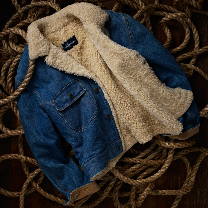 ralphlauren:   RL Vintage Collection:  Denim Shearling Camping Jacket   For warmth, Ralph Lauren added a shearling lining to this men's jacket, which was inspired by the rugged utility of a ranch hand's dungaree jacket. Circa 1985. Explore Now