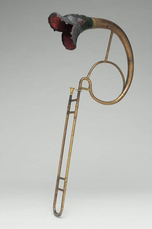 arsvitaest:  Tenor trombone (buccin) Origin: probably FranceDate: ca. 1830Location: Museum of Fine Arts, Boston   And if you don't like the music, it EATS YOU!
