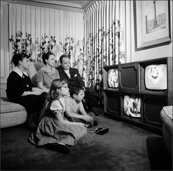"Three Screen Television 1961  ""In 1961, Chicago TV pioneer Ulises Sanabria tested the market for a three-screen television with a photo spread in LIFE magazine. I suppose the advantage it had over simply owning three individual TVs in different rooms of the house is that it kept the family together – at least, physically. A hi-fi record player is concealed behind the center speaker panel. Apparently, it was inconceivable that two or more members of a family would want to listen to different records at the same time."" the Belated Nerd"