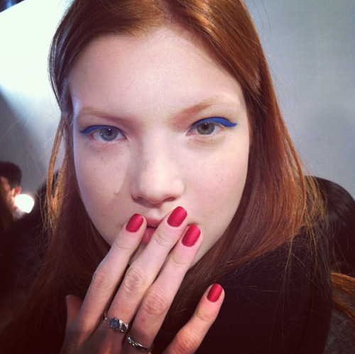 "Pops of color backstage at Honor: Nails are matte ruby ""Red Boxer Shorts"" by Deborah Lippmann.  Photographed by Lauren Drago"