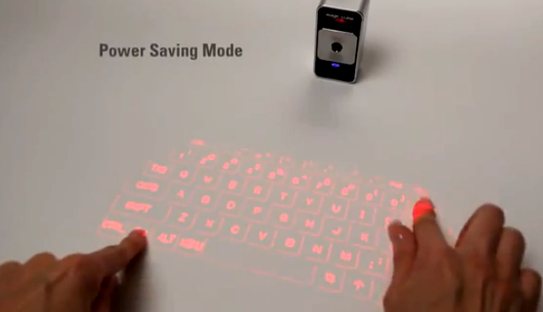 Magic Cube projects a virtual keyboard on any flat surface | CNET News The device displays a full-size virtual keyboard and multitouch mouse that people can use with their smartphones, tablets, and PCs.