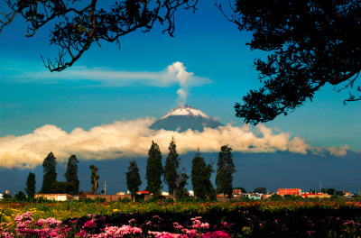 illusionwanderer:  Popocatepetl between clouds, Mexico (by Cristobal Garciaferro)