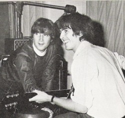thateventuality:  Scan - John is altering the volume of George's guitar while George is playing, is this photo's caption; in the studio, autumn 1964. Photo: The Beatles Book